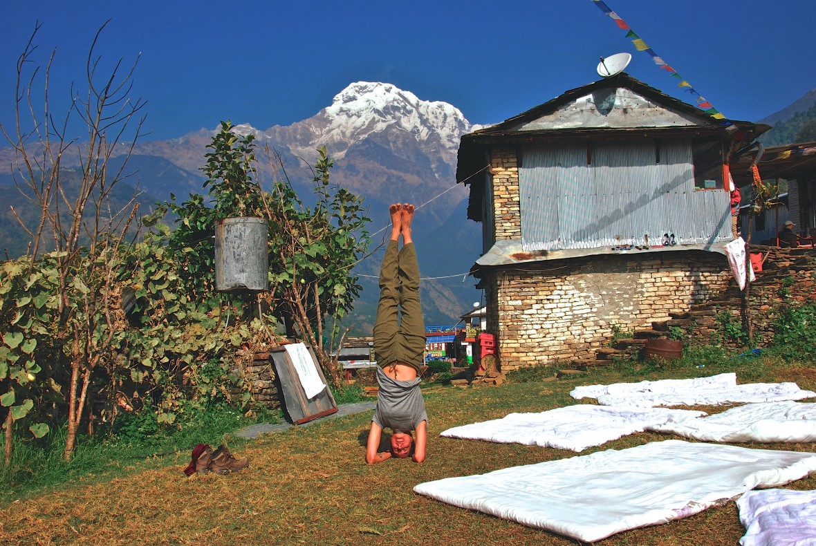 The People's Yoga instructor, Alix Northup, practicing sirsasana in the Himalayas.